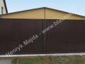 Brązowożółty garaż blaszany 6x5 o konstrukcji wzmocnionej